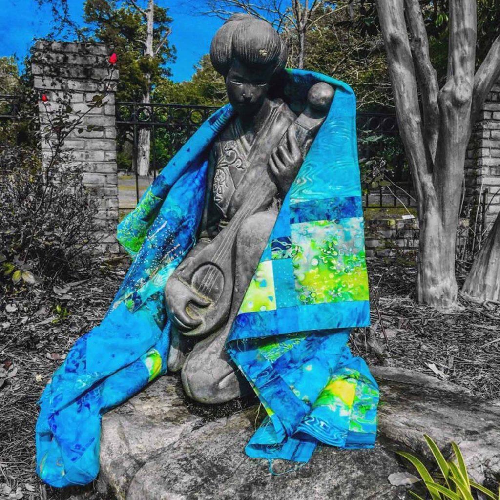 Image of batik fat quarter quilt wrapped around statue