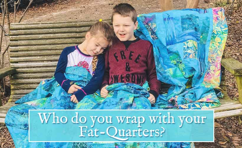 image of Kids wrapped in Batik Fat Quarter Quilt