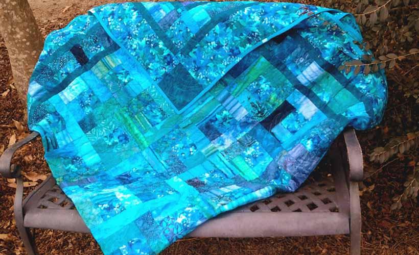 image of blue & green batik quilt