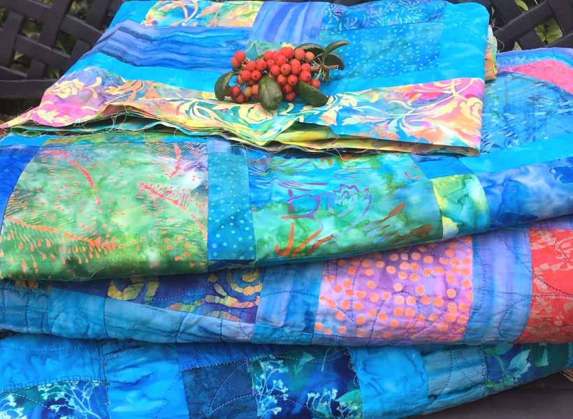 image of folded batik fat quarter quilt