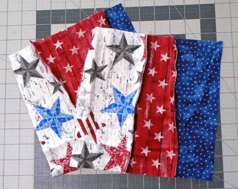 image of Three fabric strip rag quilt blocik