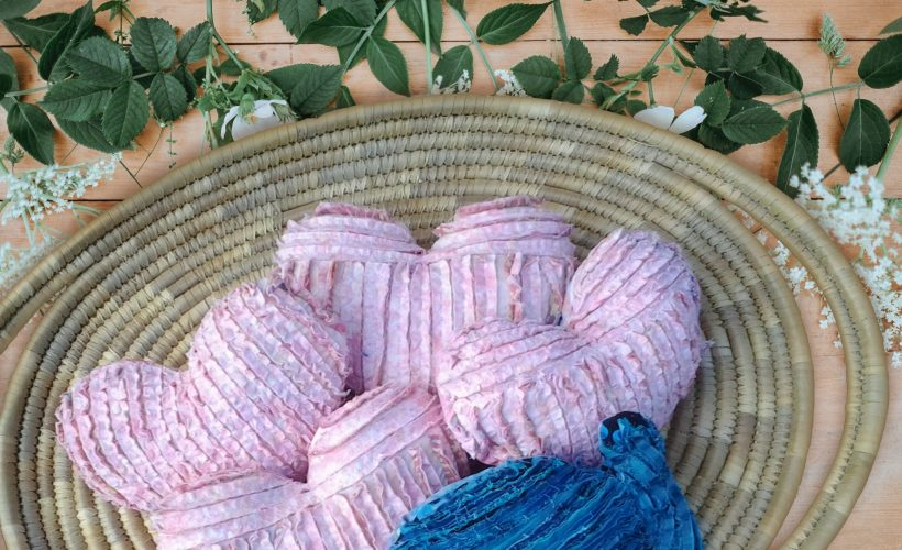 photo of chenille heart pillows in basket