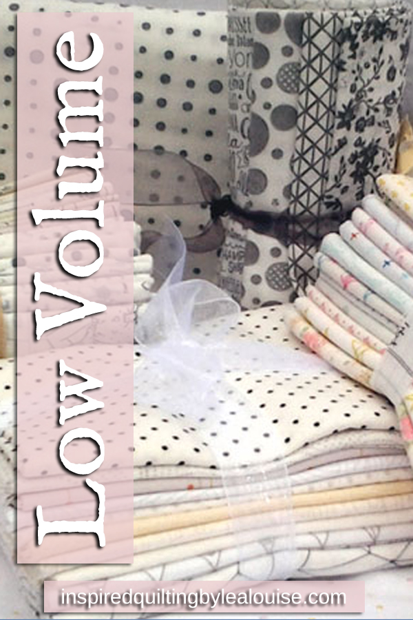 photo Low volume quilts and fabrics are neutral, light colored, prints used in an all over pattern
