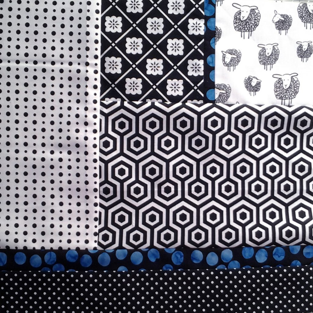 photo high contrast black & white fabrics combined with batiks