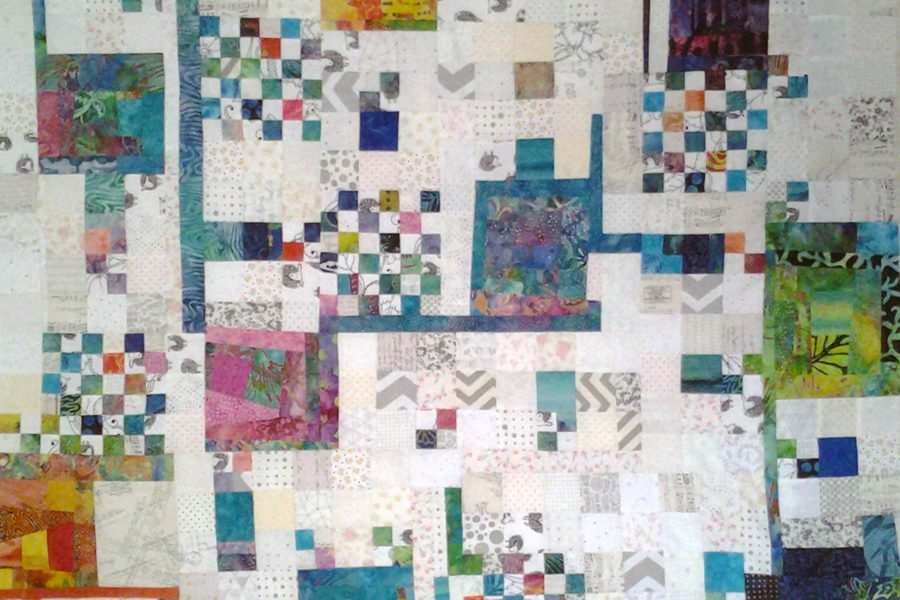 Photo of Low volume & batik improv quilting_what is improv quilting_how to layout a Low volume & batik improv quilt top
