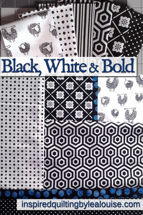 Photo of modern black & white quilt with blue batick fabric strips
