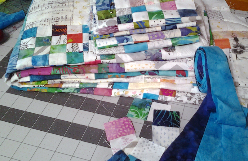 stack of folded quilt blocks ready for assembly