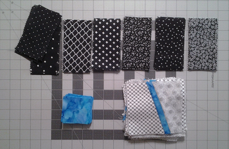 Photo Modern Improv Black White & Turquoise Quilt Block Pieces Displayed
