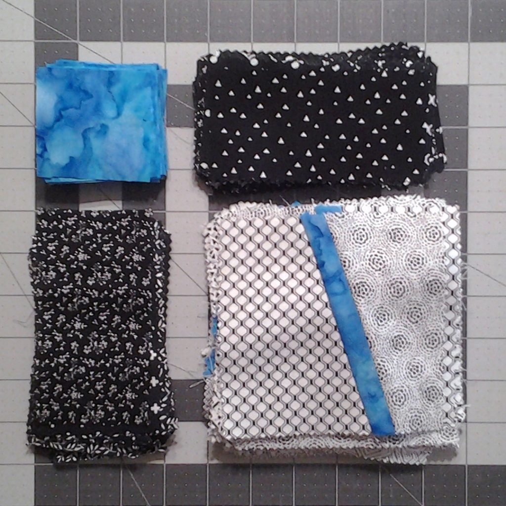 Photo Close up Modern Improv Black White & Turquoise Quilt Block Pieces Staged for Sewing