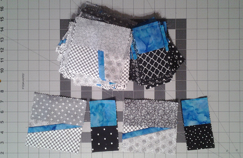 Photo Modern Improv Black White & Turquoise Quilt Block Pieces after chain stitching blocks