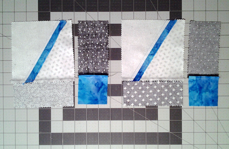 Photo Modern Improv Black White & Turquoise Quilt Block Pieces after first assembly step indicating beginning of 2nd step close up