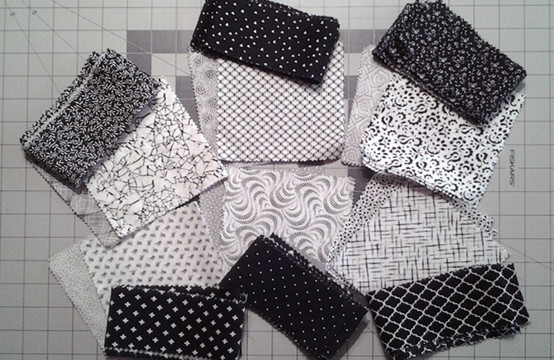 Photo of Black & White fabric squares paired with contrasting border strips