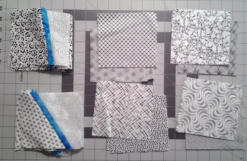 Black & White fabric squares paired up for improv piecing