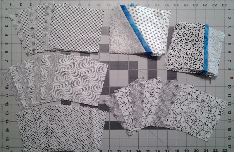 Photo Black & White fabric squares paired up in alternating order for improv piecing