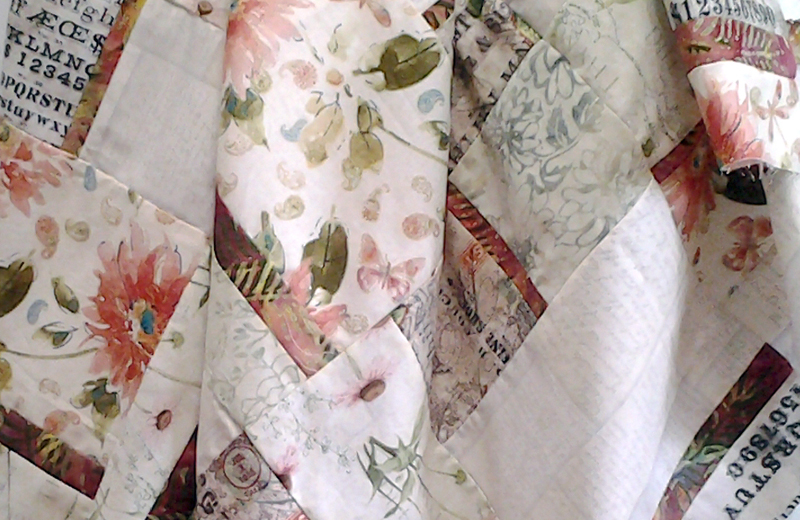 photo of Low Volume Florals & Batik Fabric Quilt