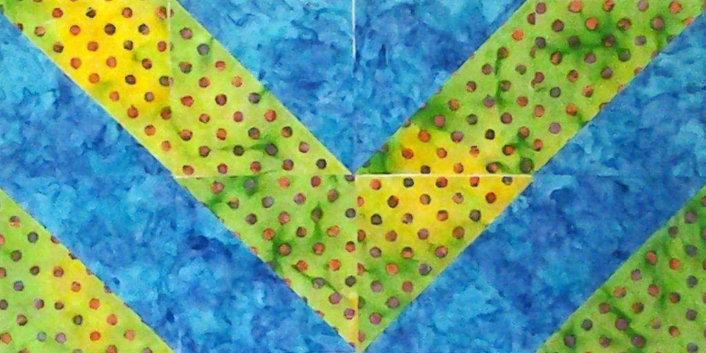 Photo of Around the World_Modern Fat Quarter Quilting with Half Square Triangles