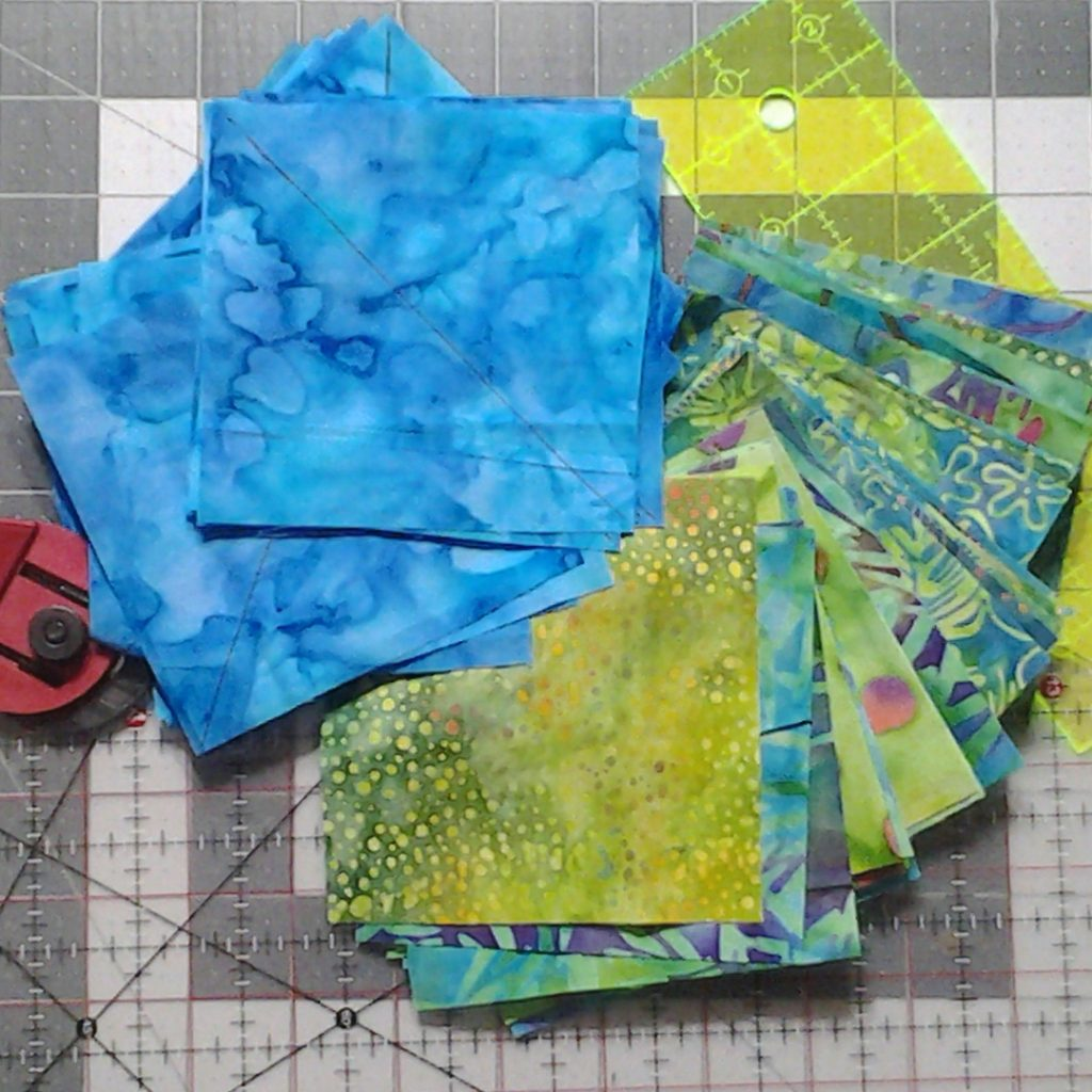 "photo of 4"" background squares marked diagonally for sewing"