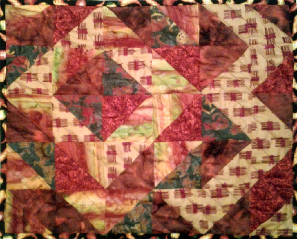 Photo of Around the World HST Mini Quilt