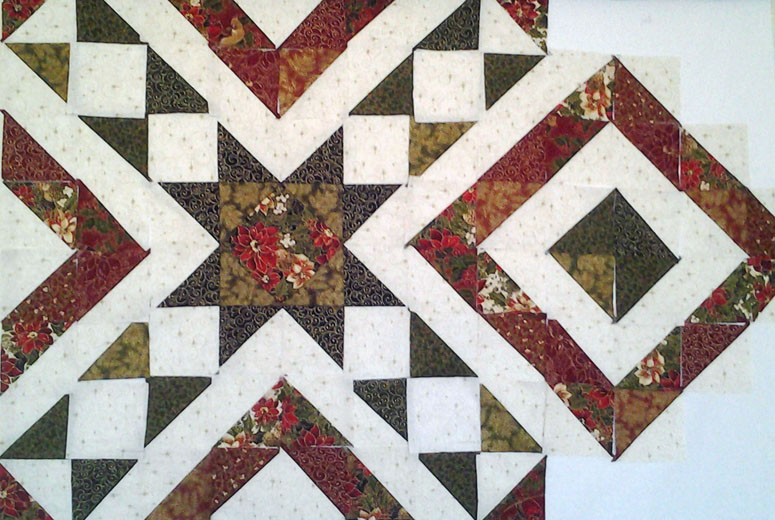 photo of Design Wall Layout of Modern Quilting with Layer Cake Half Square Triangles