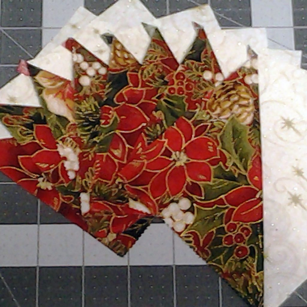 photo of Magic 8 HSTs Pressed Open to  be used in Modern Quilting with Layer Cake Half Square Triangles