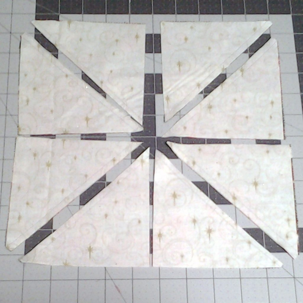 photo of Magic 8 HSTs for Modern Quilting with Layer Cake Half Square Triangles