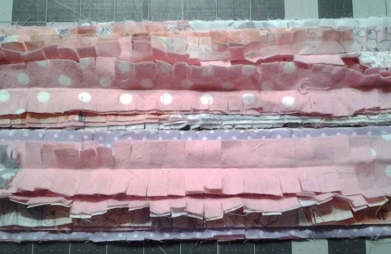 photo of Additional strips sewn to borders and then clipped