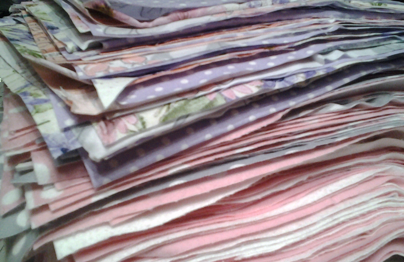 photo Stack of cut 10 inch rag quilt blocks