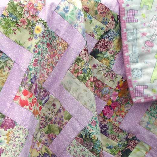 photo of Easy Rail Fence Pink Baby Quilt with Flannel Backing