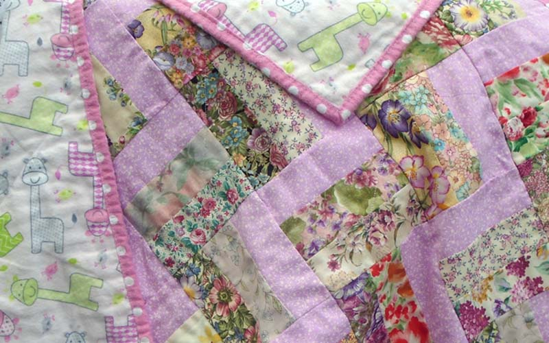 Photo of Pink Floral Rail Fence Baby Quilt