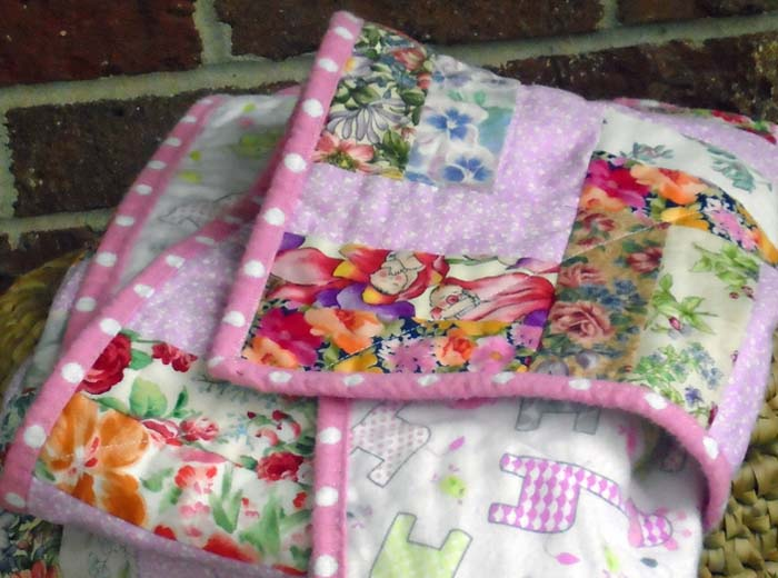 photo of folded Rail Fence Baby Quilt show how to spray baste your quilt with temporary spray adhesive