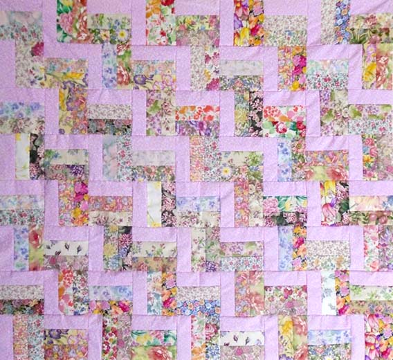 photo of Easy pink rail fence baby quilt