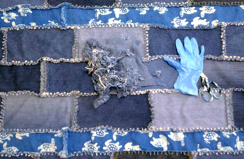 photo of Easy Blue Jean Rag Quilt with frayed edges after washing