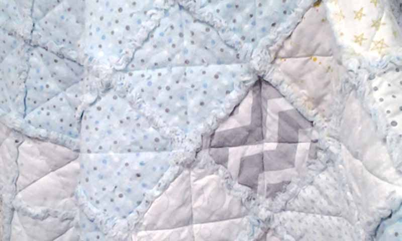 photo of Low Volume Blue Flannel Baby Rag Quilt