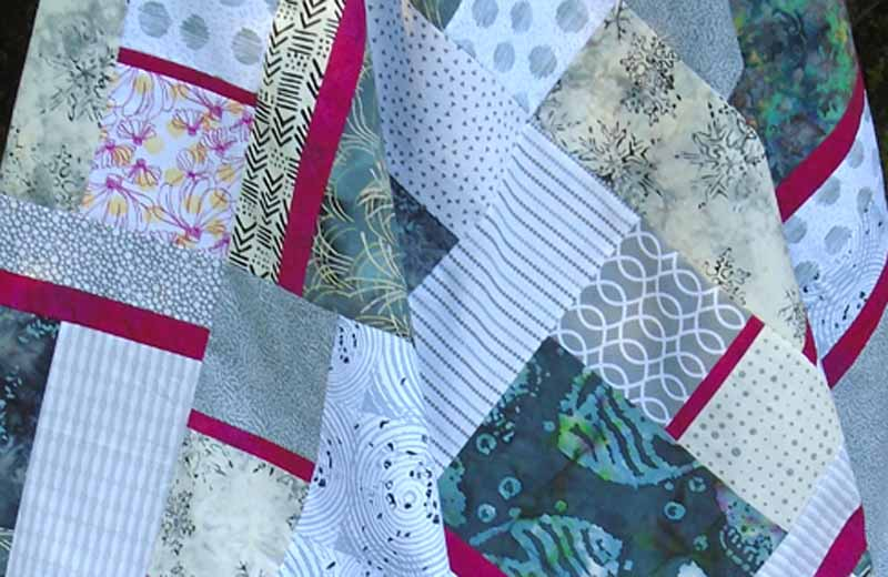 photo of Gray & Fuchsia Modern Fat Quarter Quilt