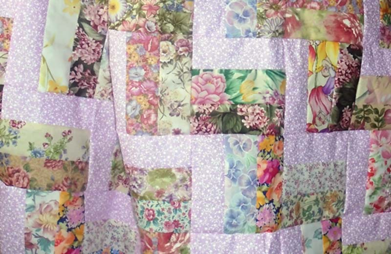photo of Easy Rail Fence Pink Baby Quilt