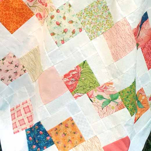 photo of Disappearing Charm Quilt Made with 5-inch Squares