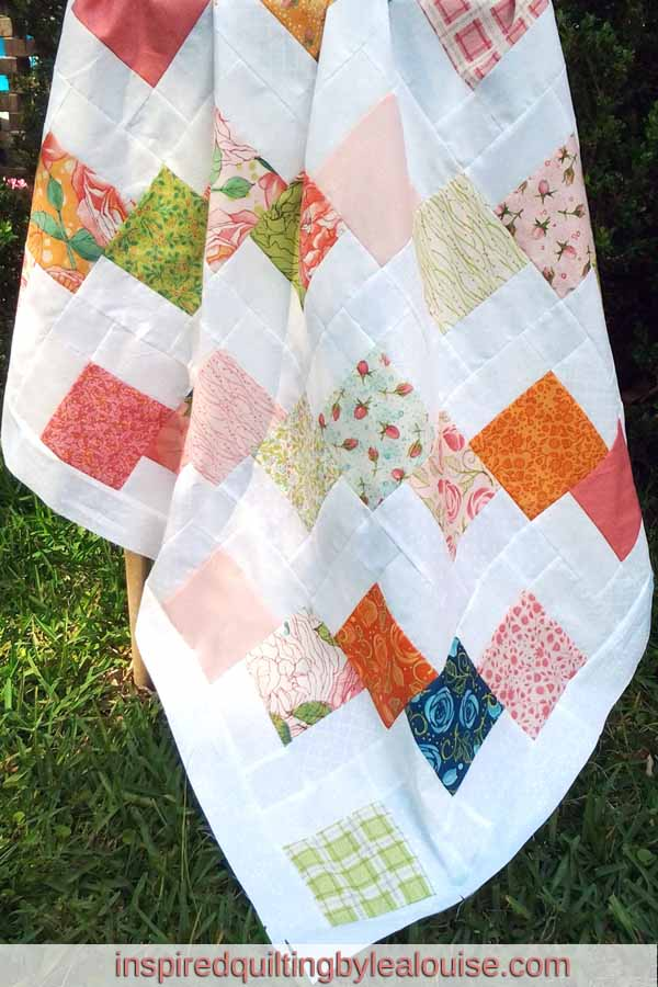 photo of Disappearing Charm Quilt Made With Charm Packs