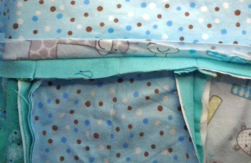 photo of how to Attach border strips to rag quilt sewing seams