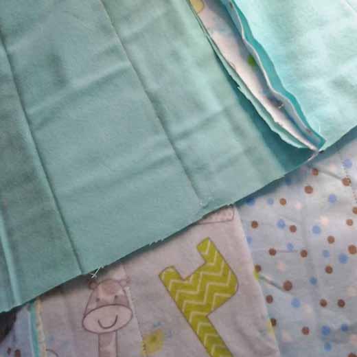 photo of flannel strip rag quilt seam placement
