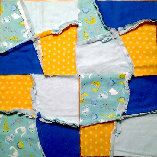 Photo of flannel baby rag quilt improv block layout