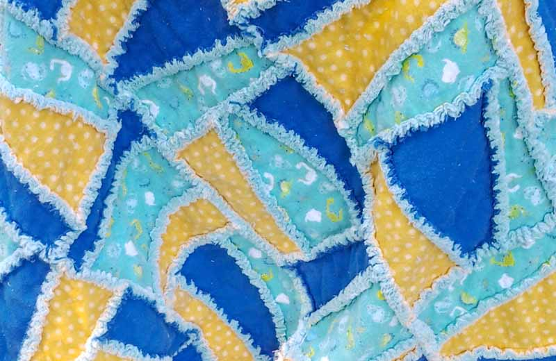 closeup photo of finished improv flannel baby rag quilt