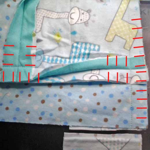 photo of how to clip seam of a flannel rag quilt