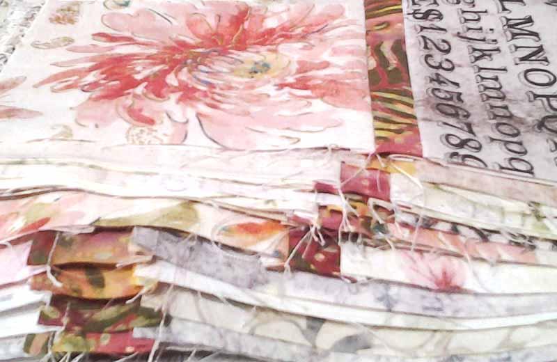 photo of Stack of Modern Low Volume & Batik Quilt Blocks in Floral Prints