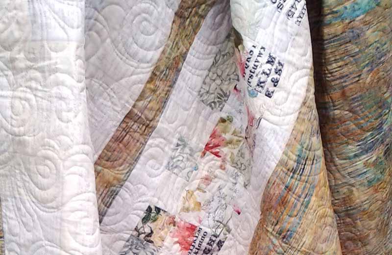 photo of Low Volume & Batik Quilt Back in Floral Fabrics