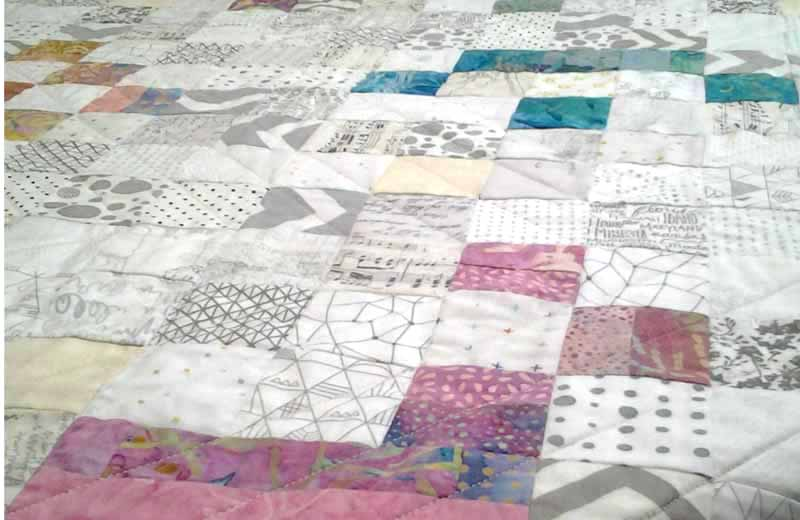 photo of View of Low Volume Quilt with Bright Batiks