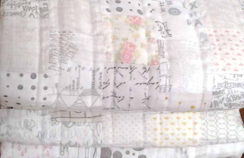 photo of low volume pink baby quilt