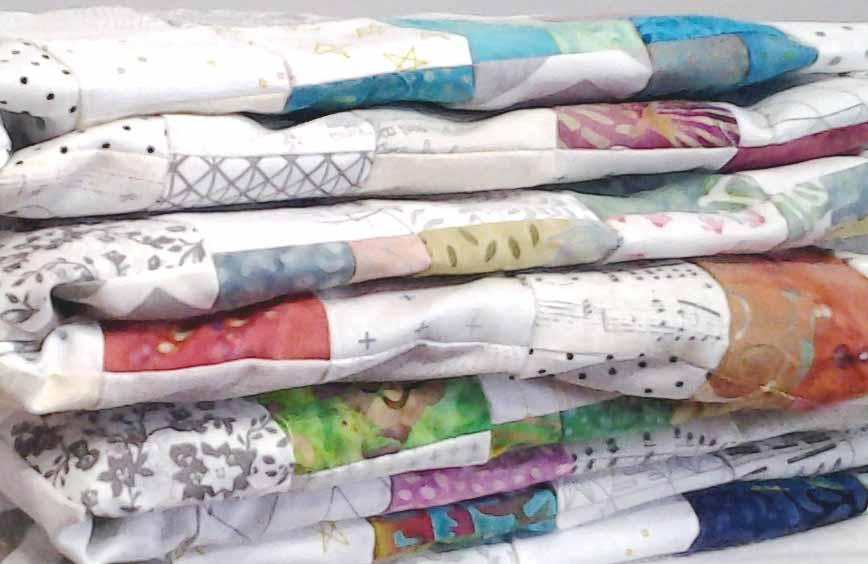 photo of low volume & batik fabric quilt