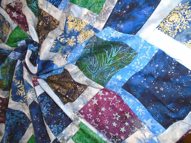 photo of Batik Charmed Blue Holiday Charm Square Quilt