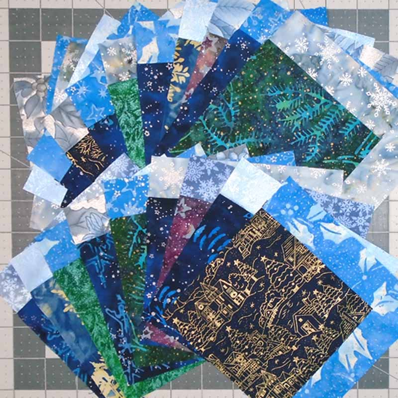 Photo of Charmed Blue Holiday Batik Charm Square Blocks