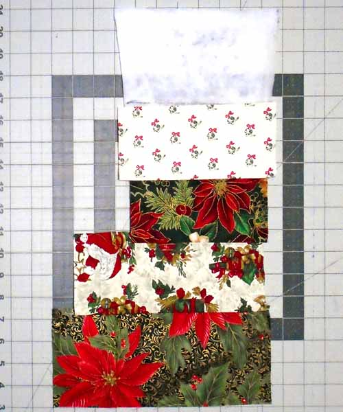 photo of Red Christmas Stocking assembly continuing to add strips until complete